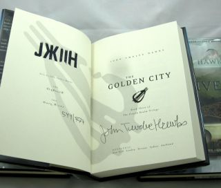 The Fourth Realm Trilogy, Comprised of The Traveler, The Dark River, and The Golden City